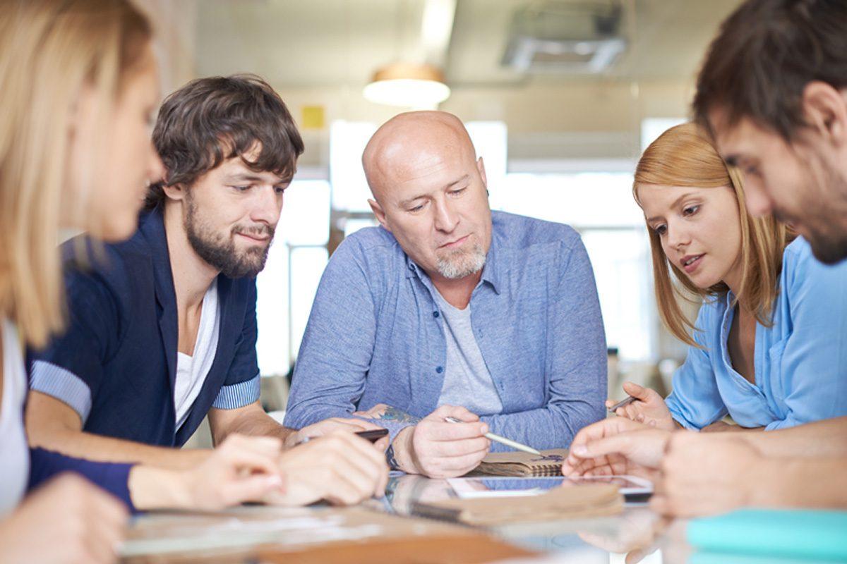 Group of pensive business people having meeting in office